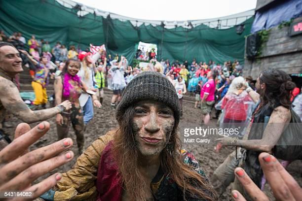 Festival revellers take part in a tomato fight at the Glastonbury Festival 2016 at Worthy Farm Pilton on June 25 2016 near Glastonbury England The...