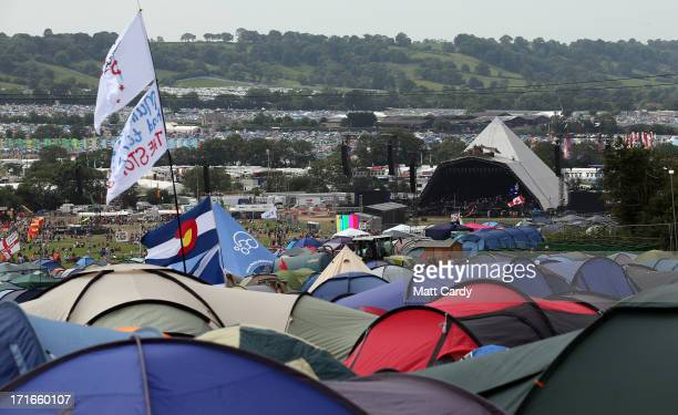 Festival tents are seen in front of the Pyramid Stage at the Glastonbury Festival of Contemporary Performing Arts site at Worthy Farm, Pilton on June...