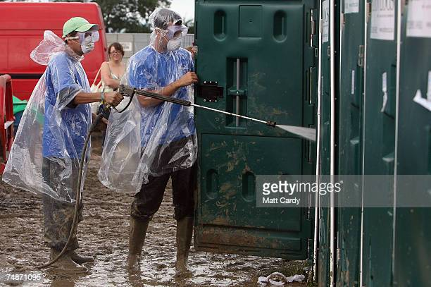 Festival toilets are cleaned at Worthy Farm Pilton near Glastonbury on June 23 2007 in Somerset England The festival that was started by dairy farmer...