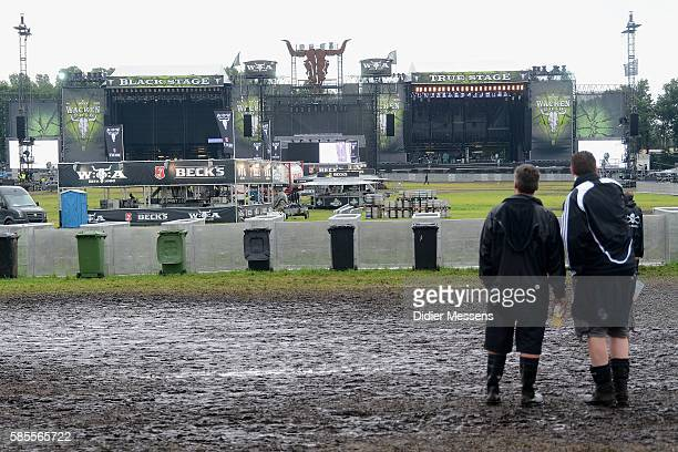 Festival visitors look at the main stages that will open on the second day of the Wacken Open Air festival on August 3 2016 in Wacken Germany Wacken...