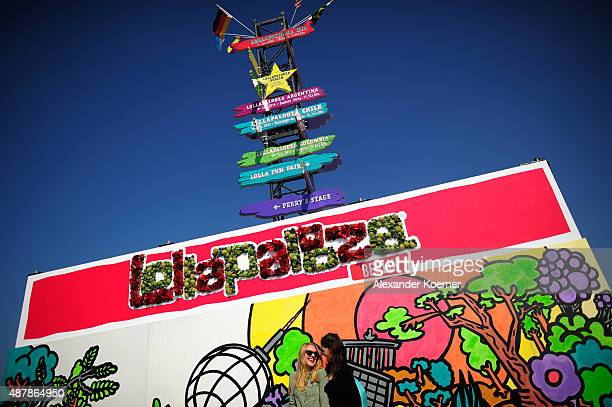 Festival visitors pose during the Lollapalooza Berlin music festival at Tempelhof Airport on September 12 2015 in Berlin Germany