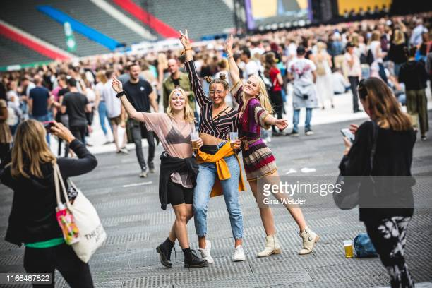 Festival visitors pose during the Lollapalooza festival at Olympiagelände on September 7, 2019 in Berlin, Germany.