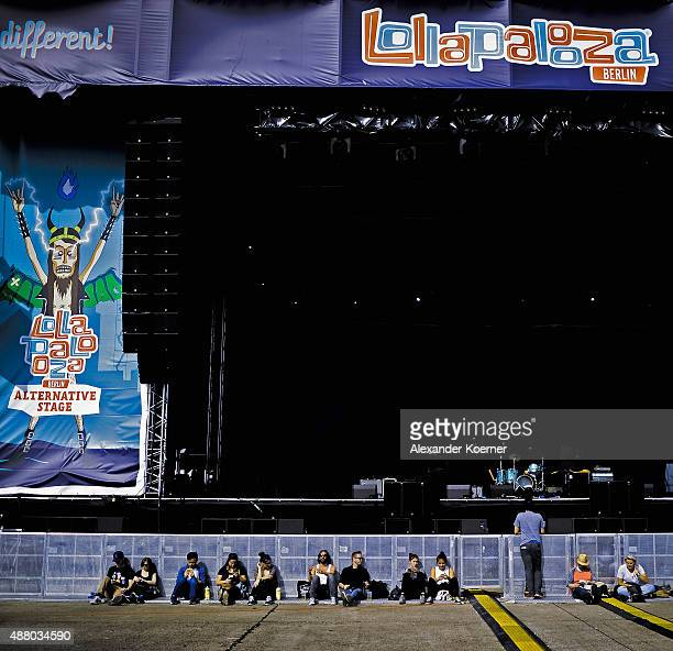 Festival visitors wait in front of a stage during the second day of the Lollapalooza Berlin music festival at Tempelhof Airport on September 13, 2015...