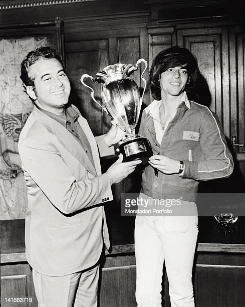 Festivalbar organizer Vittorio Salvetti presents the Trofeo Moccia to the winnen Claudio Baglioni. Asiago , summer 1974.