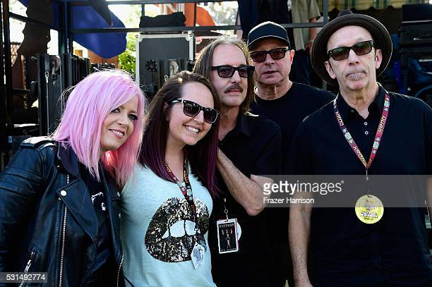 A festivalgoer and recording artists Shirley Manson Butch Vig Steve Marker and Duke Erikson of music group Garbage pose for a photo during KROQ...