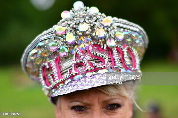 "Festivalgoer ""Glammy Glitter"" wears her Glastonbury hat as the gates are opened during day one of Glastonbury Festival at Worthy Farm Pilton on June..."