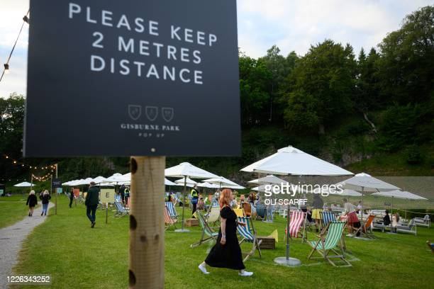 Festivalgoer makes her way to her designated pitch as she attends the Gisburne Park Pop-Up, the first purpose built socially-distanced outdoor...