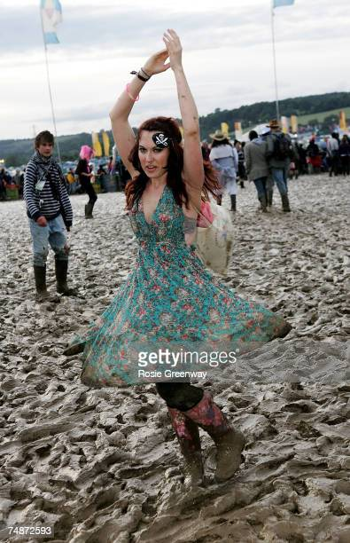 A festivalgoer named Tess dances in the mud on the second day of the Glastonbury Festival at Worthy Farm Pilton near Glastonbury on June 23 2007 in...