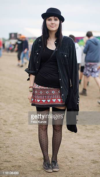 A festivalgoer poses on the fourth and final day of Roskilde Festival 2011 on July 3 2011 in Roskilde Denmark