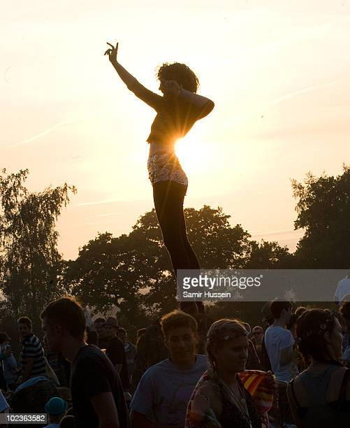 A festivalgoer relaxes at the stone circle at the Glastonbury Festival on June 23 2010 in Glastonbury England Glastonbury has become Europe's largest...