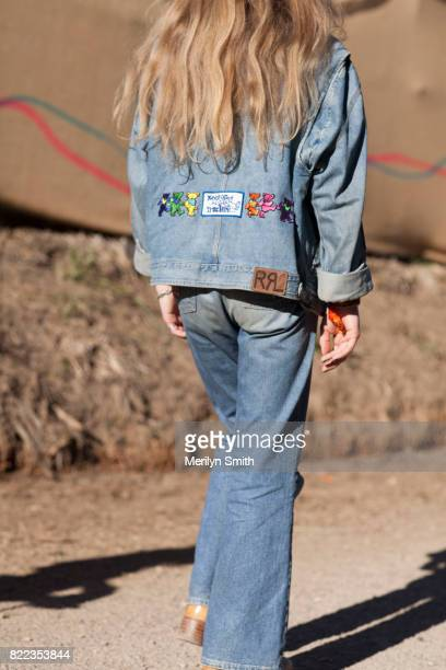 Festivalgoer wearing all denim outfit with embroidered patches during Splendour in the Grass 2017 on July 23 2017 in Byron Bay Australia