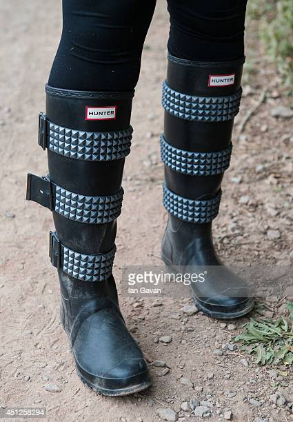 A festivalgoer wears wellington boots in preparation for rain during the Glastonbury Festival at Worthy Farm on June 26 2014 in Glastonbury England