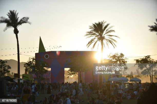 Festivalgoers and the 'is this what brings things into focus' art installation by Joanne Tathan and Tom O'Sullivan are seen during day 2 of the 2017...