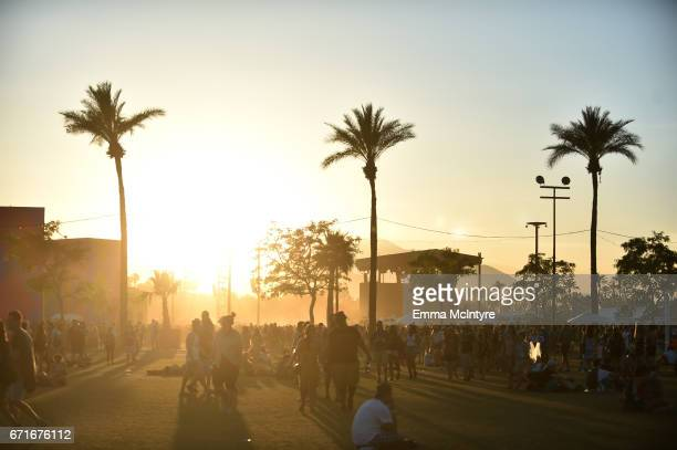 Festivalgoers are seen at sunset during day 2 of the 2017 Coachella Valley Music Arts Festival at the Empire Polo Club on April 22 2017 in Indio...