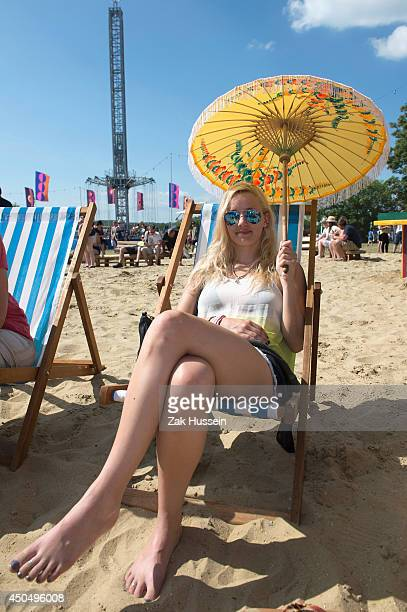 Festivalgoers arrive at The Isle of Wight Festival on June 12 2014 in Newport Isle of Wight
