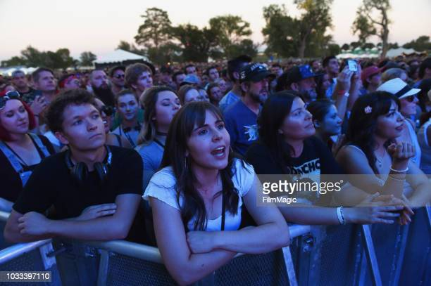 Festivalgoers attend a performance by Phoenix on the Scissor Stage during day 1 of Grandoozy on September 14 2018 in Denver Colorado