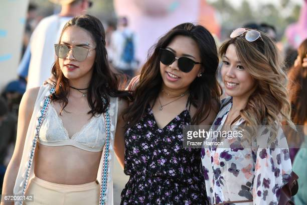 Festivalgoers attend day 2 of the 2017 Coachella Valley Music Arts Festival at the Empire Polo Club on April 23 2017 in Indio California