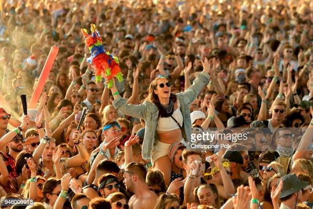 Festivalgoers attend the 2018 Coachella Valley Music And Arts Festival at the Empire Polo Field on April 13 2018 in Indio California