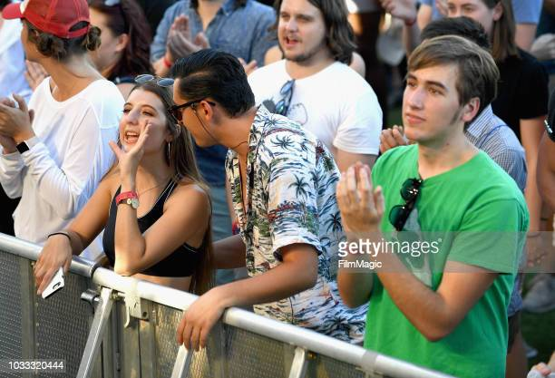 Festivalgoers attend the Tennis performance on the Paper Stage during day 1 of Grandoozy on September 14 2018 in Denver Colorado