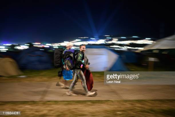 Festival-goers begin to make their way home in the early hours of Monday morning as the final acts finish their sets at Glastonbury Festival at...