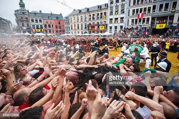 Festivalgoers celebrate the 'Ducasse de Mons' or 'Doudou' folkloric festival in Mons May 22 2016 The Doudou feast compromises two parts a procession...