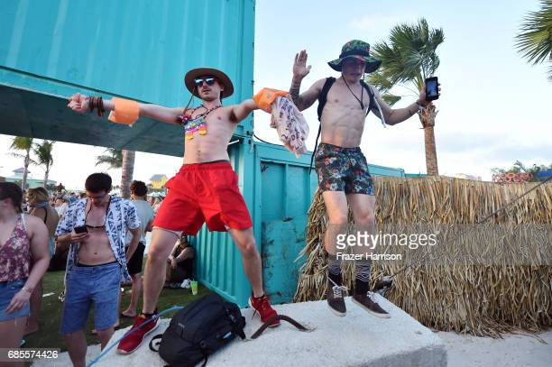 Festivalgoers dance during 2017 Hangout Music Festival on May 19 2017 in Gulf Shores Alabama