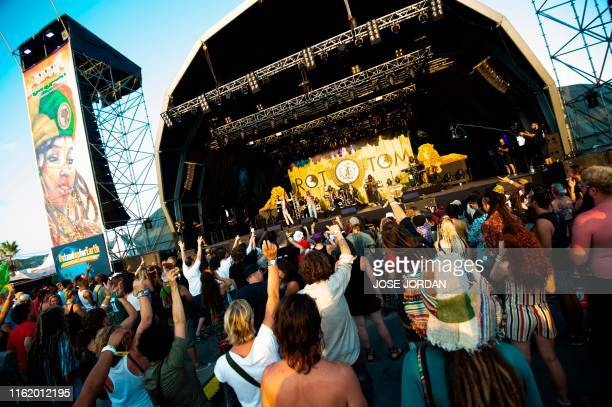 Festival-goers dance during a concert by the Jamaican band The Abyssinians on the first day of the Rototom Sunsplash European Reggae Festival in...