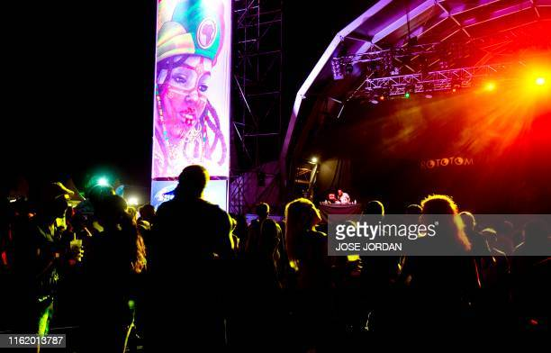 Festival-goers dance during the first day of the Rototom Sunsplash European Reggae Festival in Benicassim, Castellon province, on August 16, 2019. -...