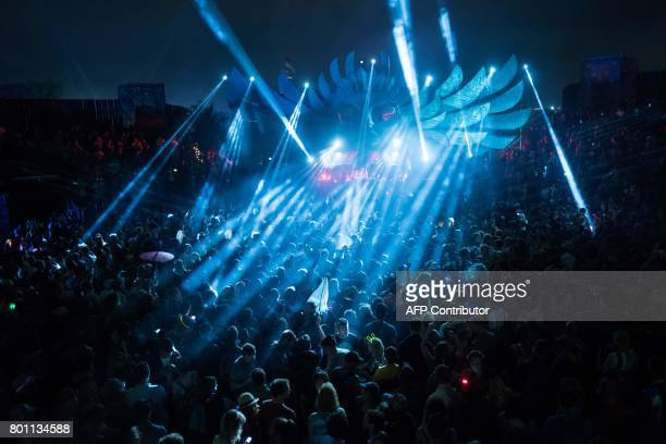 Festivalgoers dance in The Common area of the Glastonbury Festival of Music and Performing Arts on Worthy Farm near the village of Pilton in Somerset...