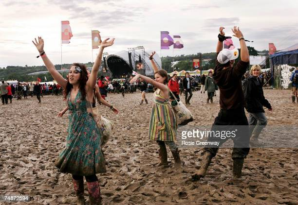 Festivalgoers dance in the mud on the second day of the Glastonbury Festival at Worthy Farm Pilton near Glastonbury on June 23 2007 in Somerset...