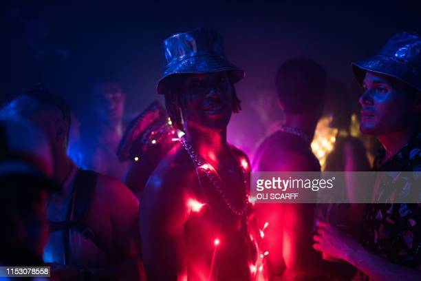 Festival-goers dance in the NYC Downlow club in the Block9 area of the Glastonbury Festival of Music and Performing Arts on Worthy Farm near the...