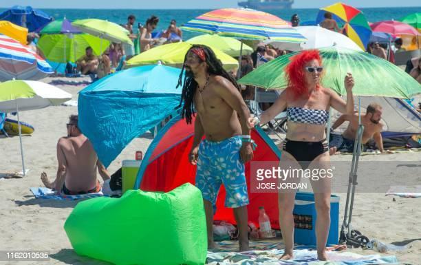 Festival-goers dance on the Gurugu beach during the first day of the Rototom Sunsplash European Reggae Festival in Benicassim, Castellon province, on...