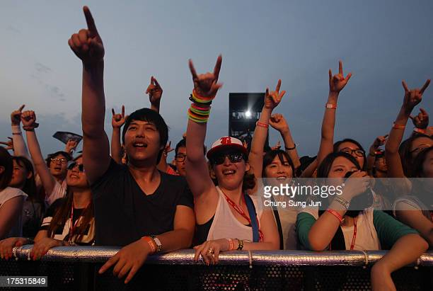Festivalgoers enjoy a performance during day 1 of the Pentaport Rock Festival on August 2 2013 in Incheon South Korea