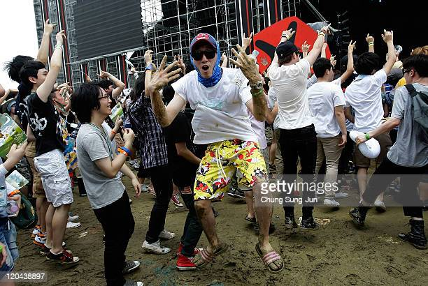 Festivalgoers enjoy a performance during day two of the Pentaport Rock Festival at Dream Park on August 6 2011 in Incheon South Korea