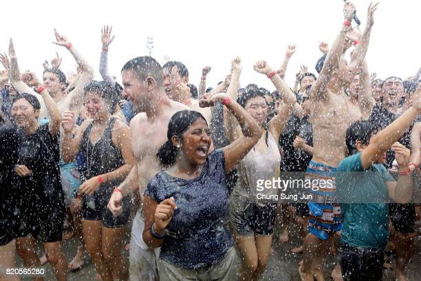Festivalgoers enjoy during the annual Boryeong Mud Festival at Daecheon Beach on July 22 2017 in Boryeong South Korea The mud which is believed to...