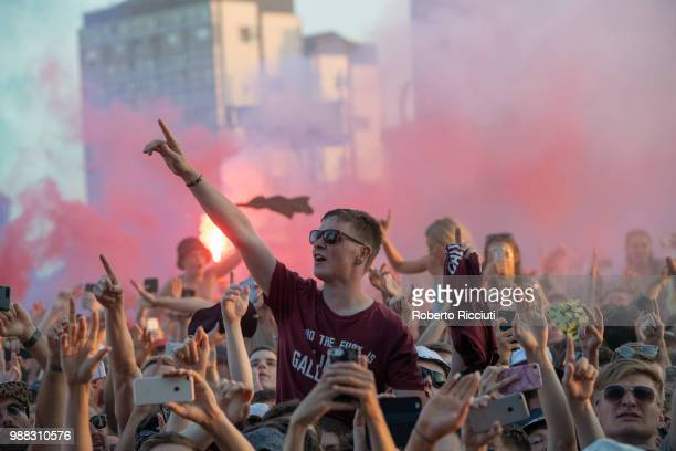 Festivalgoers enjoy Liam Gallagher's concert on the second day of the TRNSMT music Festival on Glasgow Green on June 30 2018 in Glasgow Scotland