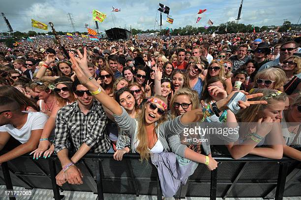 Festivalgoers enjoy the atmosphere at the Pyramid stage during day 2 of the 2013 Glastonbury Festival at Worthy Farm on June 28 2013 in Glastonbury...