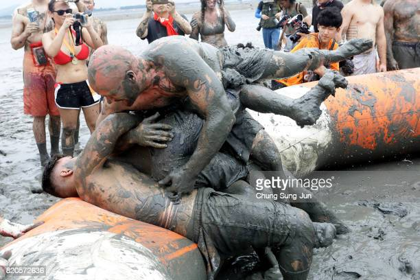 Festivalgoers enjoy the mud during the annual Boryeong Mud Festival at Daecheon Beach on July 22 2017 in Boryeong South Korea The mud which is...