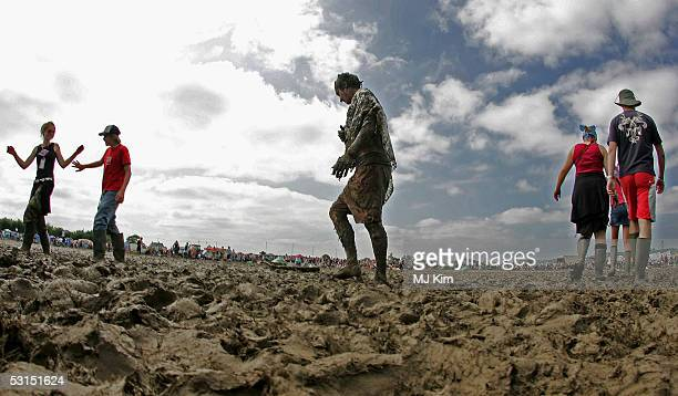 Festivalgoers enjoy the mud on the third and final day of the Glastonbury Music Festival 2005 at Worthy Farm Pilton on June 26 2005 in Somerset...