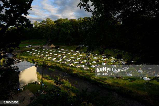 Festivalgoers experience the Gisburne Park Pop-Up, the first purpose built socially-distanced outdoor festival in the UK, whilst in their designated...