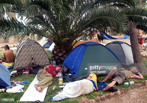 Festivalgoers find shelter from the sun during the International Festival of Benicassim on July 22 2007 in Benicassim Spain The festival attracts...
