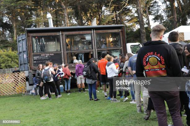 Festivalgoers get pizza at the 2017 Outside Lands Music And Arts Festival at Golden Gate Park on August 11 2017 in San Francisco California
