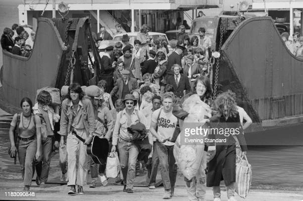 Festival-goers getting of the ferry to attend the Isle of Wight Festival, Afton Down, UK, 26th-31st August 1970.