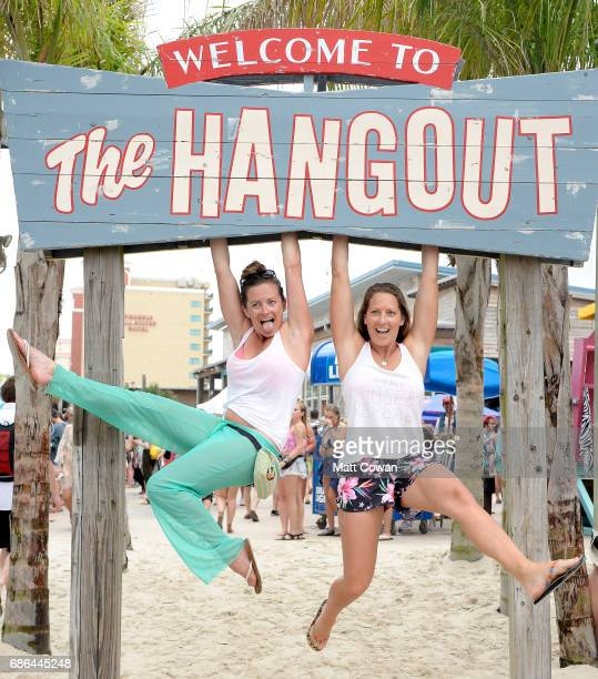Festivalgoers hang ovv the Welcome To The Hangout sign during 2017 Hangout Music Festival on May 21 2017 in Gulf Shores Alabama