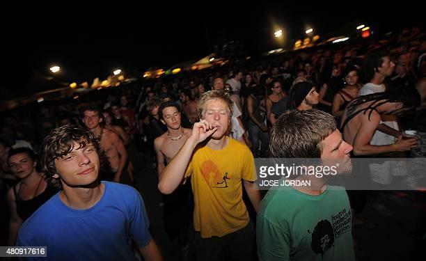 Festivalgoers listen to performers at the Rototom Sunsplash European reggae festival in Benicassim Spain on August 21 2010 The festival runs from...
