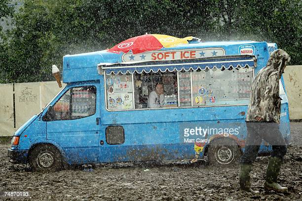 Festivalgoers negotiate around the site in the rain near to the Pyramid Stage at Worthy Farm Pilton near Glastonbury on June 23 2007 in Somerset...