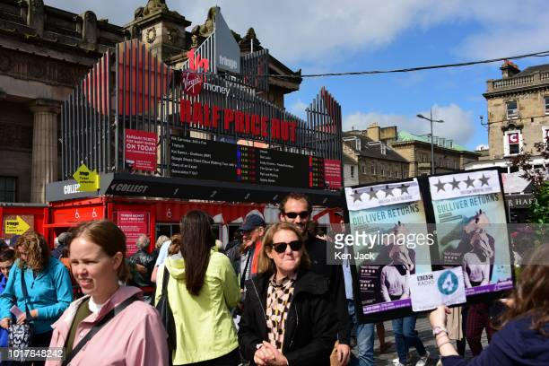 Festivalgoers on The Mound precinct around the 'Half Price Hut' ticket office during the Edinburgh Festival Fringe on August 16 2018 in Edinburgh...