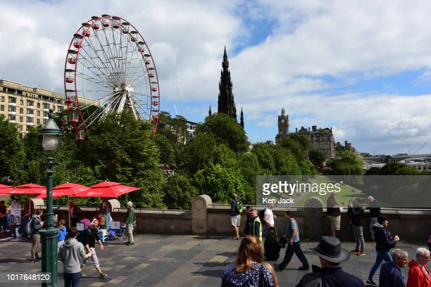 Festivalgoers on The Mound precinct overlooking Princes Street Gardens Princes during the Edinburgh Festival Fringe on August 16 2018 in Edinburgh...