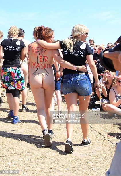 Festivalgoers participate in a naked run to win next years tickets on Day 3 of the Roskilde Festival on July 6 2013 in Roskilde Denmark