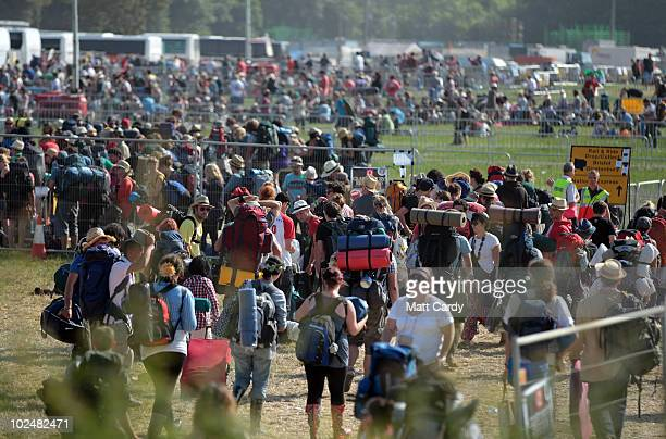 Festival-goers queue for coaches as they leave the 40th Glastonbury Festival at Worthy Farm, Pilton on June 28, 2010 in Glastonbury, England. Many...